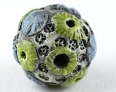 Dark Cornflower Blue Textured Sprigs with Chartreuse Yellow Crators and Blackish Gray Background Stoneware Ceramic Bead