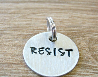 Resist Pendant, Resist Charm, Resist Disc, customize wording, hand stamped, Melody Upper font, add to necklace, bracelet, or keychain