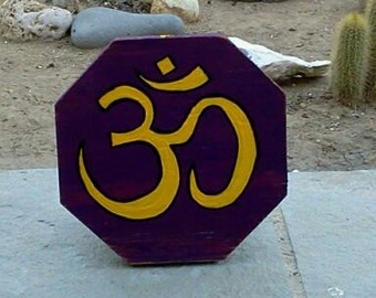 OM Sign painted on wood