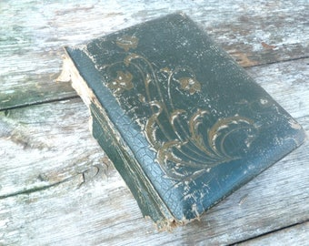 Antique 1900s photo album dark green leather adorned with flowers empty timeworn