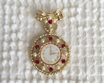 Vintage Pearl and Ruby Rhinestone Brooch With Faux Watch Face Dangling from a Bow Accent - Unique and Pretty