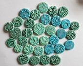 SPECIAL PRICE...clay coins with embossed designs...colors of the ocean