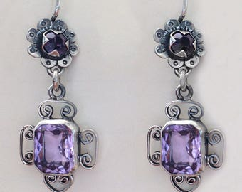 Flowers with purple bead and same color crystal on bottom. Frida style
