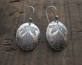 Etched leaf oval earrings by teresamatheson