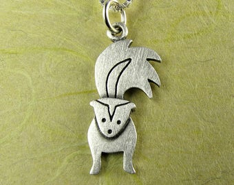 Tiny skunk necklace / pendant