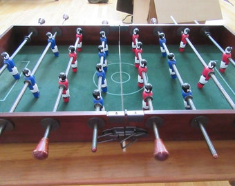 Reduced...Vintage fold up Foosball game- very good condition, ready to use, folds up when not in use- comes with three balls