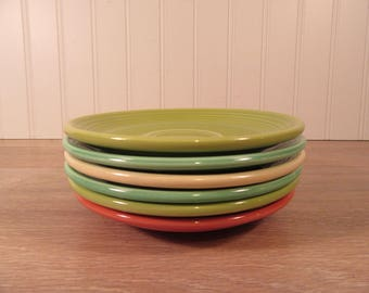 Six vintage Fiesta cup saucers for one price