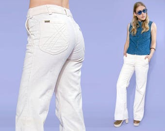 70s Levi's white corduroy flared pants, size small