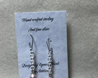 Peach pearl on chain earrings.