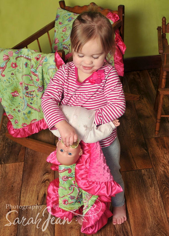 Little girl holding a dolly with her luvy