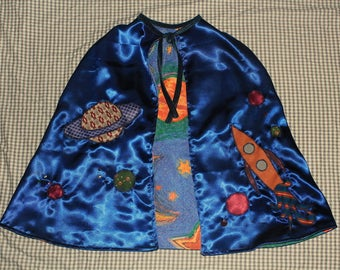 reversible space cape appliqued with planets and rockets