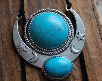 Sun and Moon Bolo Statement Necklace. Black Suede Cord Bolo with Antique Silver Metal and Faux Turquoise.