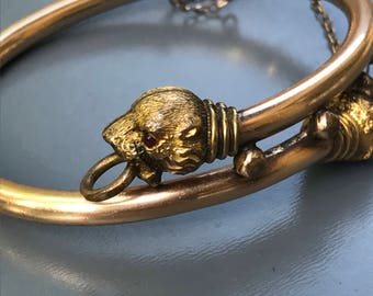 Antique Victorian bangle . Double Lion head . Gold filled Jewelry . Small wrist size .