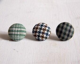 Lapel pin. Mens lapel button. Round boutonniere. Moss green, dark green. Geometric buttonhole. Plaid. Houndstooth.