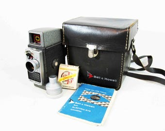 Vintage Bell and Howell 8mm Electric Eye Camera with Accessories and Case. For Parts or Display Only. Circa 1950's.