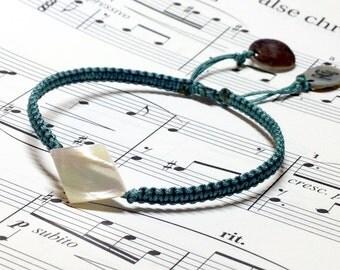 WAS 15.00,NOW 9.00 vintage shell bead adjustable friendship bracelet