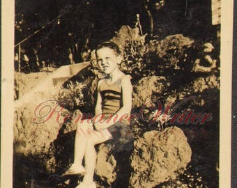 C09304 Cute Little Girl in Bathing Suit Sits on Rocks Vintage Photo Antique