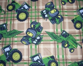 John Deere tractors and farm equipment on brown plaid cotton Fabric- 15 inches wide and sold by the yard