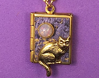 Cat Love Locket, purple and gold, holding 14 ways to say 'I love you' from English to American Sign Language.
