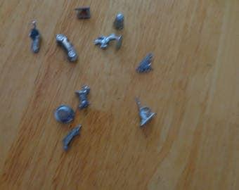 Silver color Monopoly pieces  10