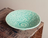 Stoneware bowl in teal glaze with Australian Flannel Flower design