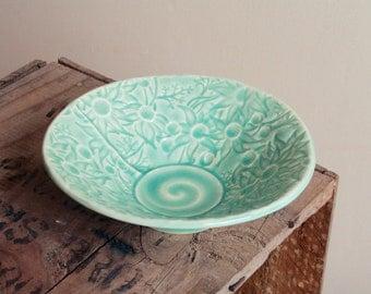 Stoneware bowl in teal glaze with Australian Flannel Flower design
