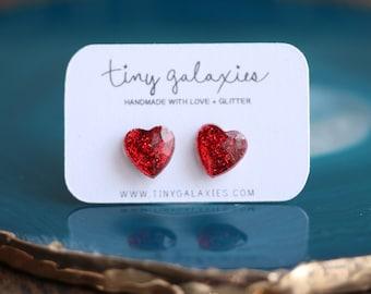 red glitter heart earrings on sterling silver posts