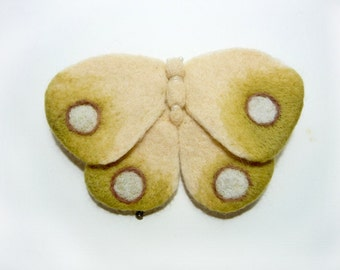 A felt brooch -  pale moth