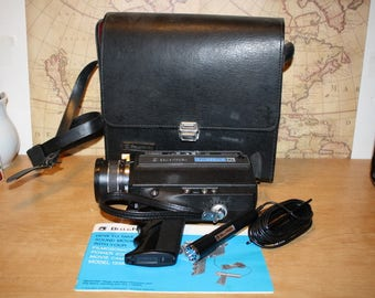 Vintage Movie Camera Bell and Howell Model 1235 - item #2512