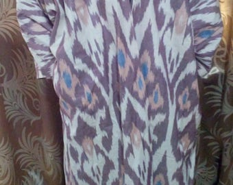 Uzbek traditional cotton ikat long chapan. Adras kaftan, tribal ethnic coat