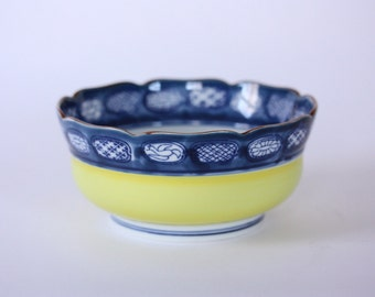 Vintage round porcelain yellow bowl from Japan