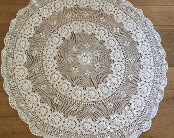 A pretty, vintage crocheted circular lace tablecloth.