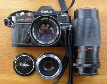 Konica Autoreflex T4 35mm SLR Camera with 50mm f1.7, 2X Vivitar Tele Converter, and Promaster 80-200mm f4.5 Zoom Lens