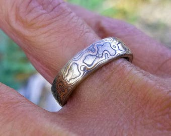 Unique river nature wedding band textured tri color mokume gane red gold white gold and sterling