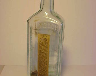 c1897 Hood's Sarsaparilla C. I. Hood Co. Lowell, Mass. , Aqua Blown Glass Medicine bottle with the original paper label