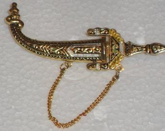 Brooch Dasmasquino a small dagger style of the 50s