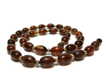 "Vintage pressed baltic amber beaded necklace, deep cognac oval beads, hidden screw closure 23"",  8.3 grams"