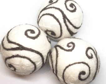 Pure wool felted dryer balls set of three in cream with brown swirls with drawstring cotton bag in natural.