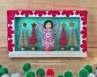 Pink Angel - small wood diorama.  Wood angel, pink with vintage lace. Mini trees. Glittery pale green, pink, and white.
