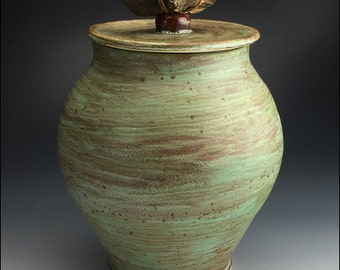 large green LIDDED JAR   weathered wood handle strapped with suede