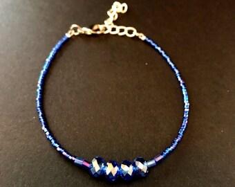 Blue seed bead glass bead bracelet.