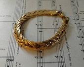 Retro 1980's Gold Tone Braided Bracelet by Monet - Regency Gold Fine Costume Jewelry Gift, Flat Braided Gold Tone Bracelet, Costume Jewelry