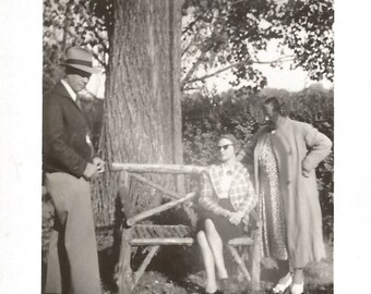 """Vintage Snapshot """"Serious Discussion"""" Odd Photo Man Wearing Fedora Woman On Bench Wearing Sunglasses Found Vernacular Photo"""