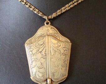 ANTIQUE BRASS LOCKET pendant on a fine chain