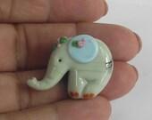 Lampwork glass miniature sculpture. Cute baby elephant bead. SRA.