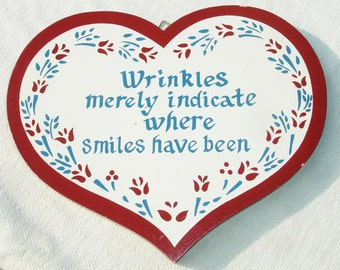 """Vintage """"Wrinkles merely indicate where smiles have been"""" Heart Shaped Wooden Sign"""