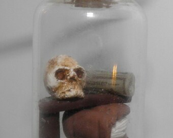 A Wizards Work Table in a Glass Vial Pendant