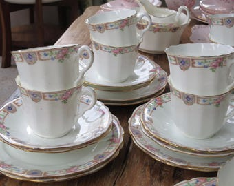 Antique china coffee cup trio