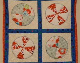 Whimsical Aqua & Red Spiral quilted wall hanging