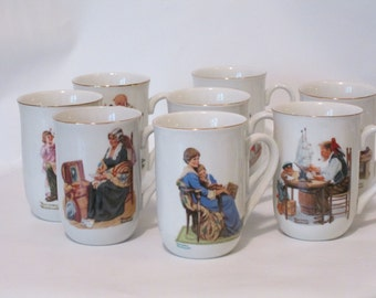 Norman Rockwell Set of 8 Porcelain Mugs.  Never Used in Original Box. 1982